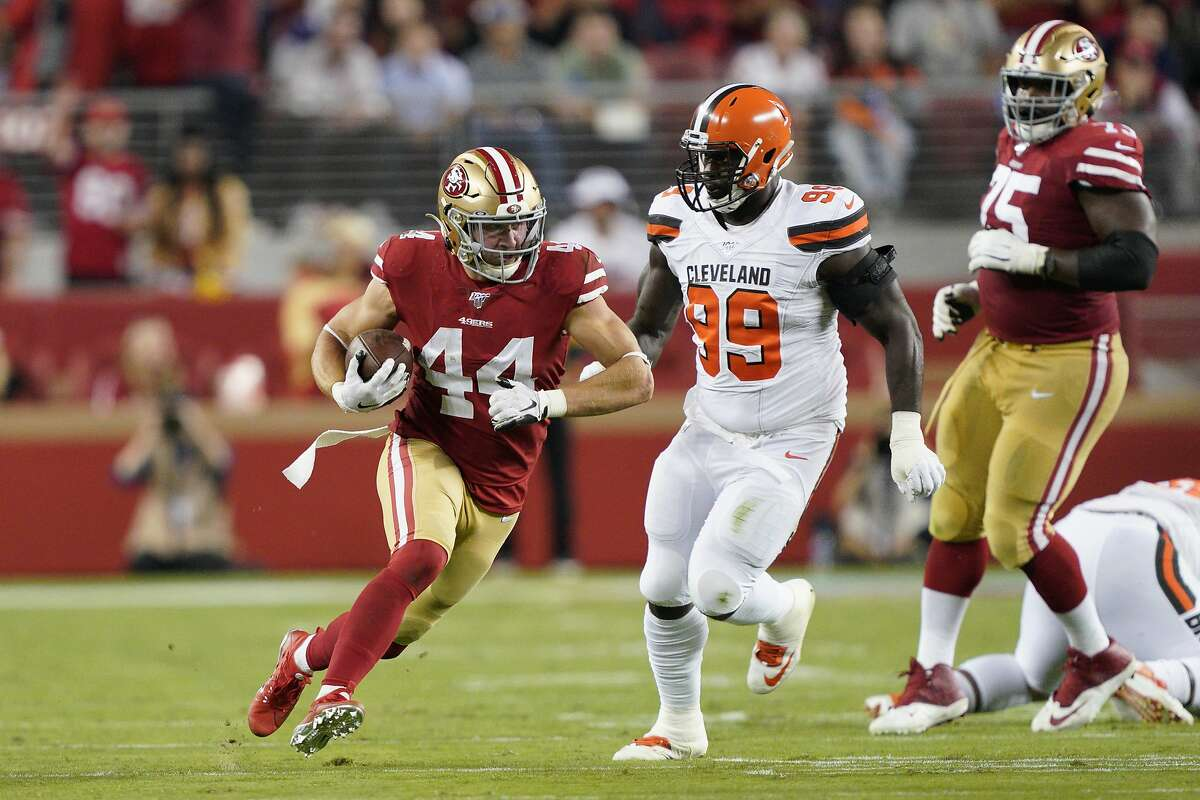 San Francisco 49ers fullback Kyle Juszczyk (44) runs in front of Cleveland Browns defensive tackle Devaroe Lawrence (99) during an NFL football game in Santa Clara, Calif., Monday, Oct. 7, 2019. (AP Photo/Tony Avelar)