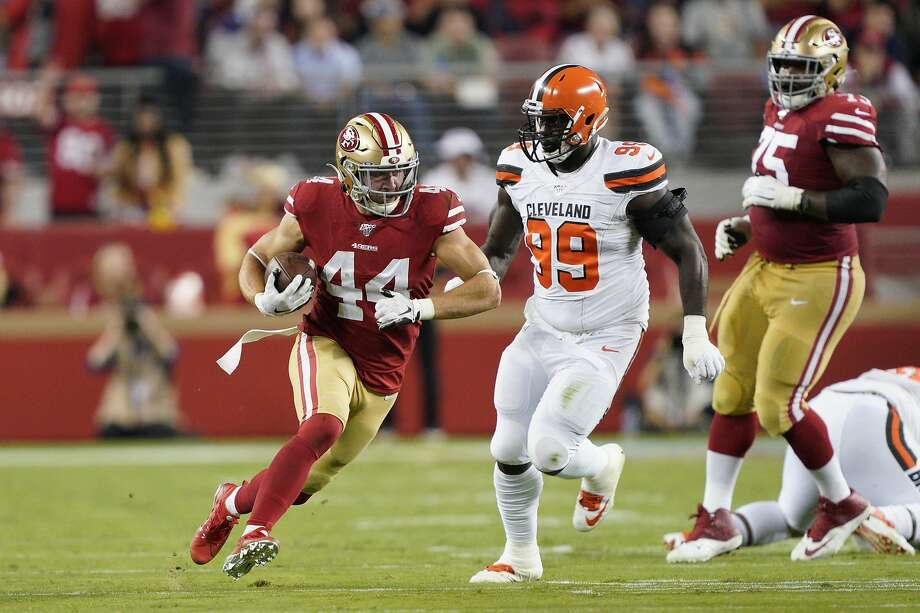 San Francisco 49ers fullback Kyle Juszczyk (44) runs in front of Cleveland Browns defensive tackle Devaroe Lawrence (99) during an NFL football game in Santa Clara, Calif., Monday, Oct. 7, 2019. (AP Photo/Tony Avelar) Photo: Tony Avelar / Associated Press