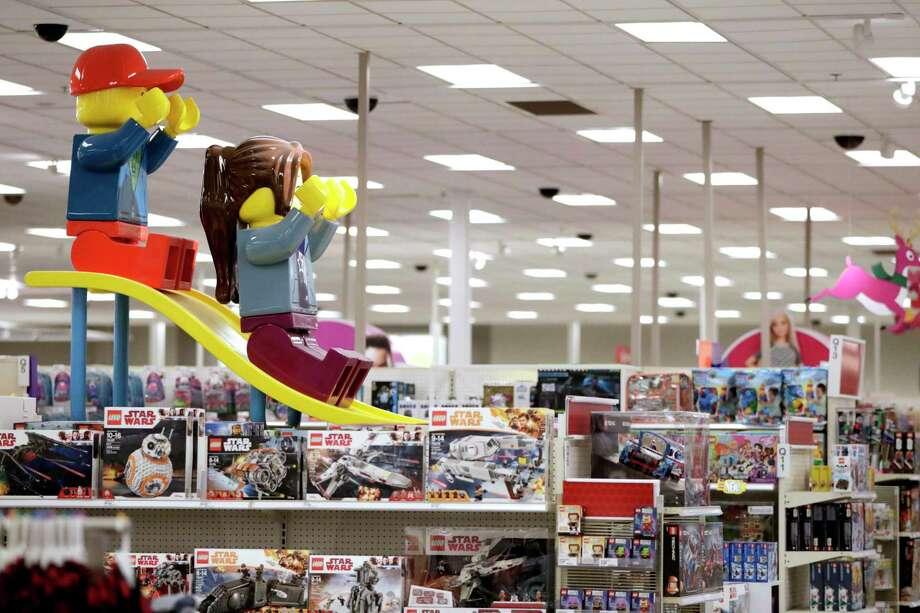 FILE- In this Friday, Nov. 16, 2018, file photo photo a display shows two large Lego toys on a slide near the toy section at a Target store in Bridgewater, N.J.  The parent company of Toys R Us is turning to a rival to restart its e-commerce business ahead of the holiday shopping season. Tru Kids Brands is teaming up with discounter Target Corp. to relaunch Toysrus.com, according to a joint release. (AP Photo/Julio Cortez, File) Photo: Julio Cortez / Copyright 2018 The Associated Press. All rights reserved.