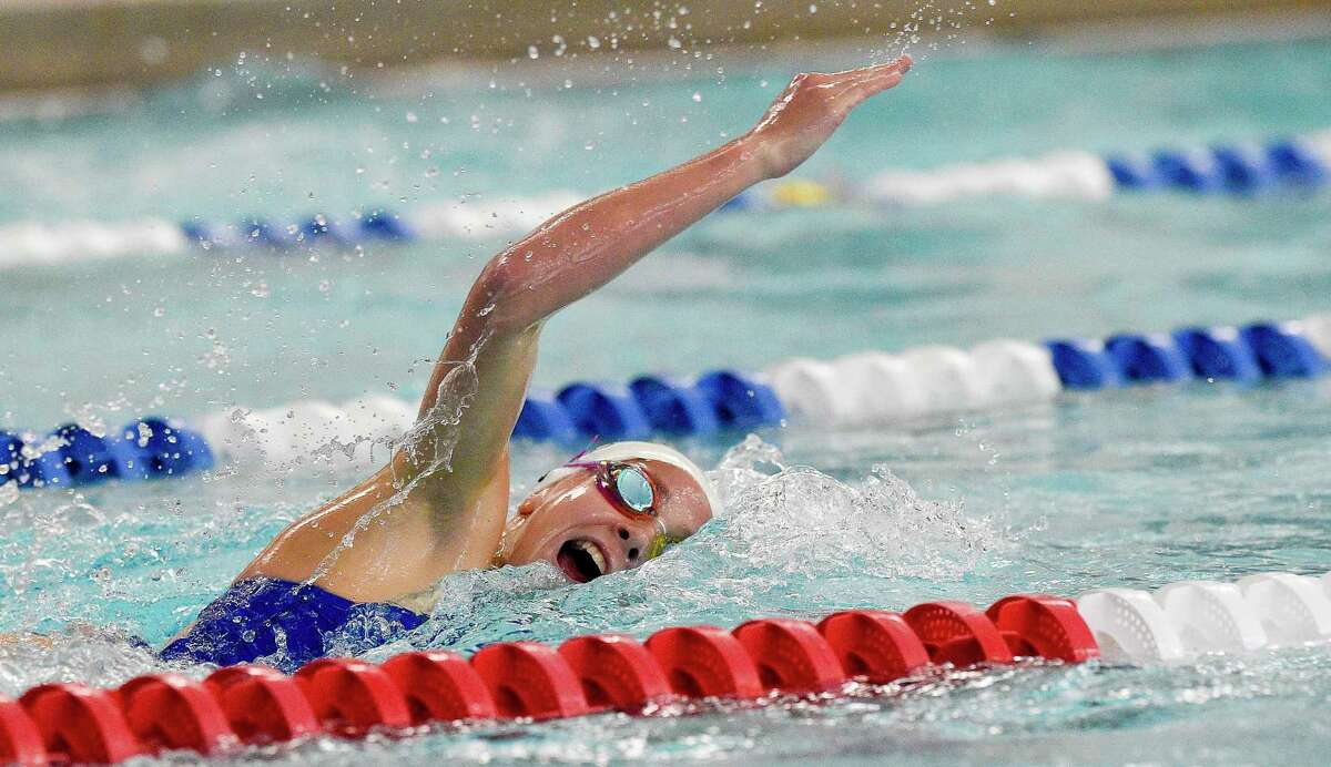 Darien's Meg Erickson competes in the 200 individual medley against New Canaan on Wednesday.