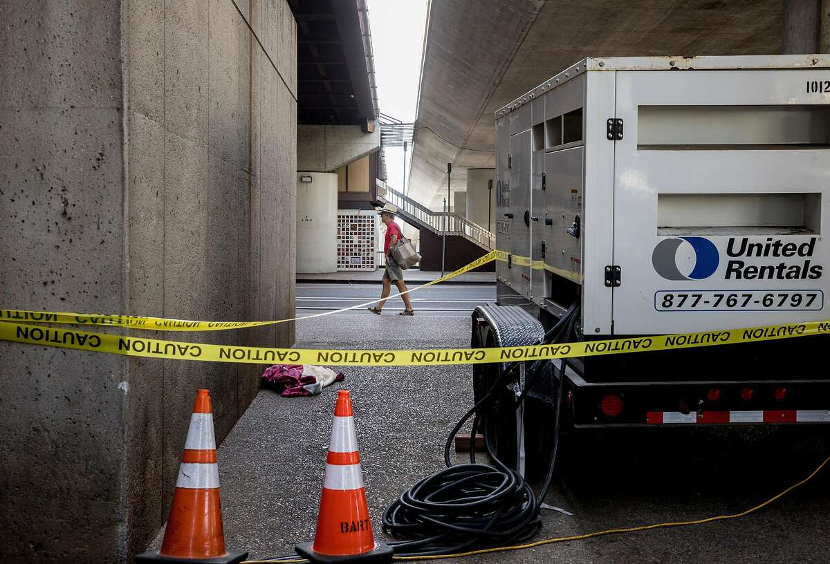 A portable generator is seen hooked up to Rockridge BART Station in Oakland, Calif. Tuesday, Oct. 8, 2019 ahead of a possible PG&E Public Safety Power Shutoff scheduled for many Bay Area customers.