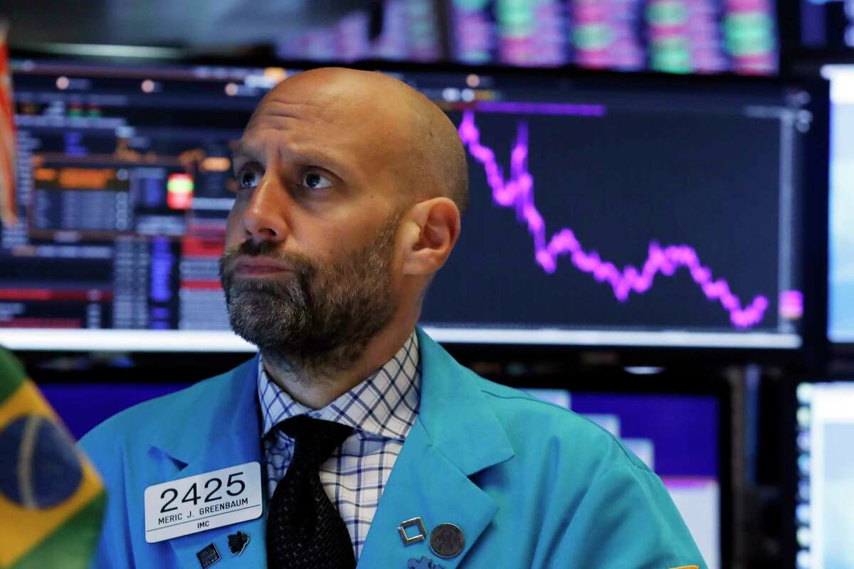 Specialist Meric Greenbaum works at his post on the floor of the New York Stock Exchange, Tuesday, Oct. 8, 2019. Stocks are opening lower on Wall Street as tensions rose between Washington and Beijing just ahead of the latest round of trade talks. (AP Photo/Richard Drew)