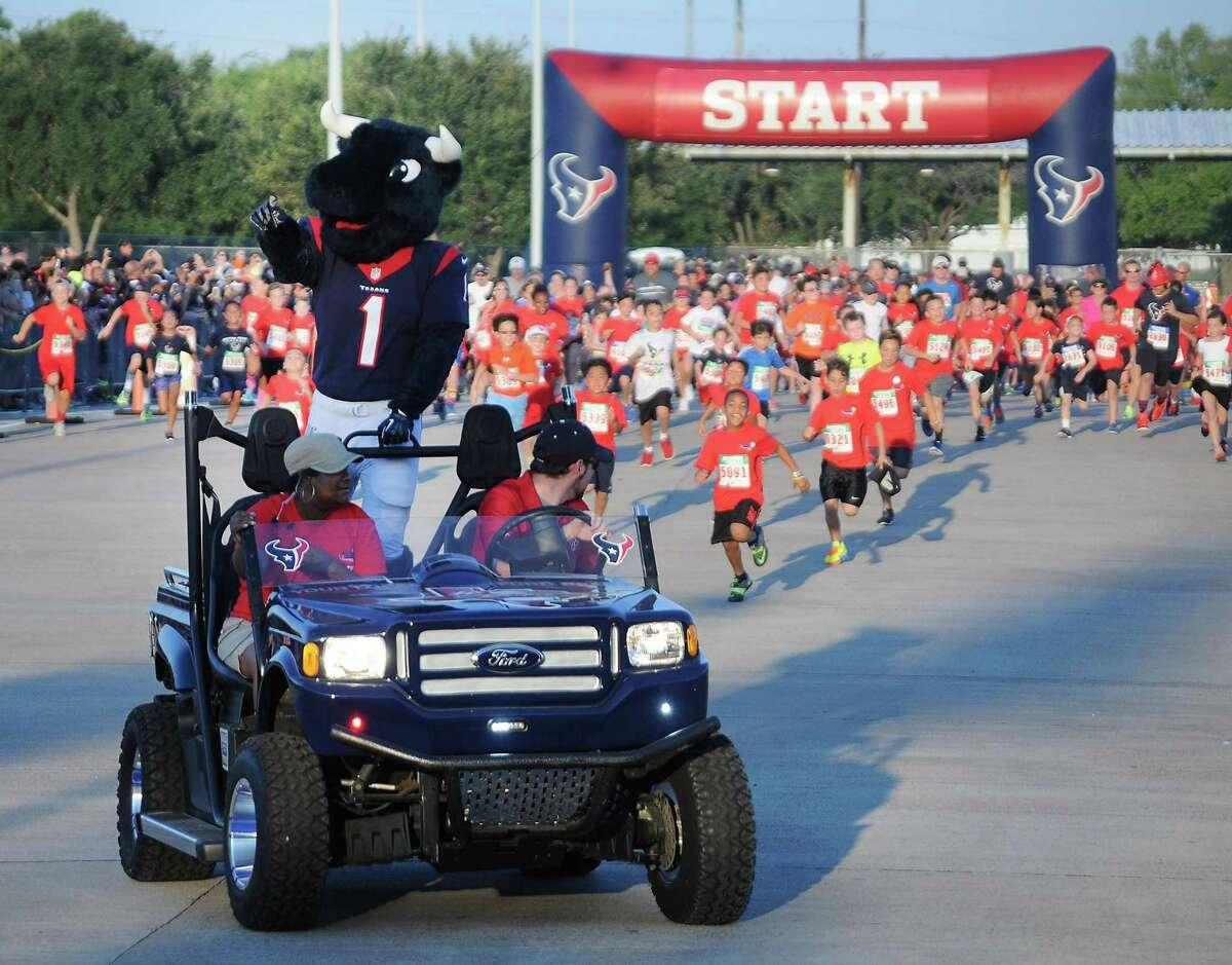 Toro leads the kids' run at the Running of the Bulls.