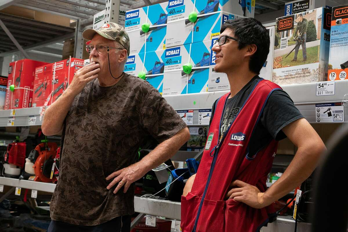 Don Maben of Pittsburg, left, speaks with Lowe's employee, Jesus Villalobos about purchasing a generator at Lowe's in Antioch, Calif., on Tuesday, Oct. 8, 2019.