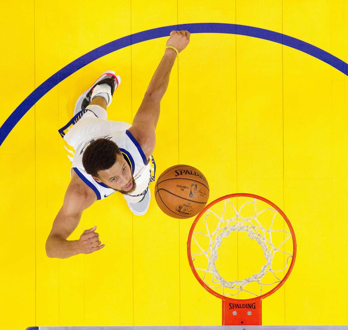 Stephen Curry (30) puts in a layup in the first half as the Golden State Warriors played the Los Angeles Lakers in a pre-season game at Chase Center in San Francisco, Calif., on Saturday, October 5, 2019.