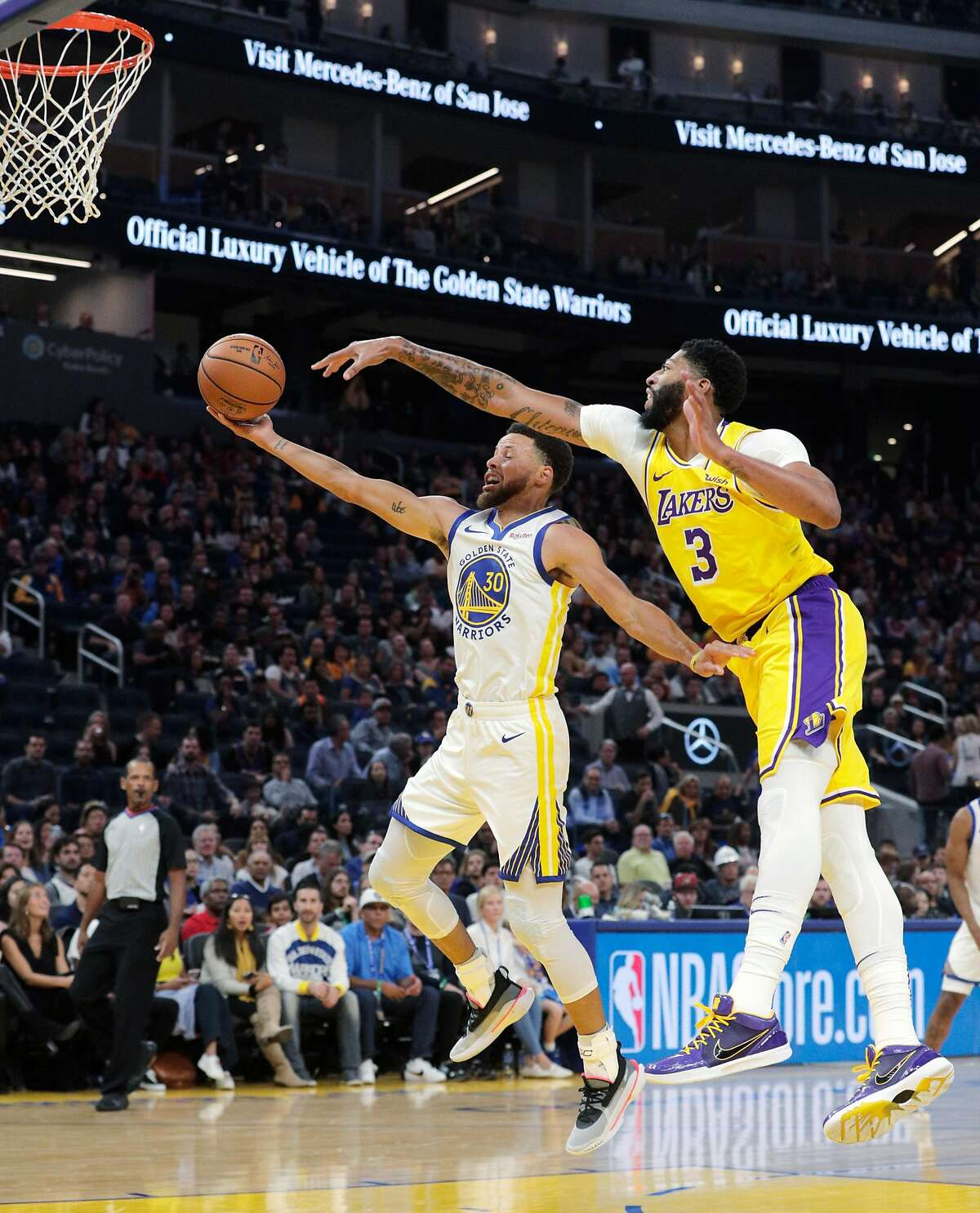 Anthony Davis (3) tries to defend against Stephen Curry (30) In the first half as the Golden State Warriors played the Los Angeles Lakers in a pre-season game at Chase Center in San Francisco, Calif., on Saturday, October 5, 2019.