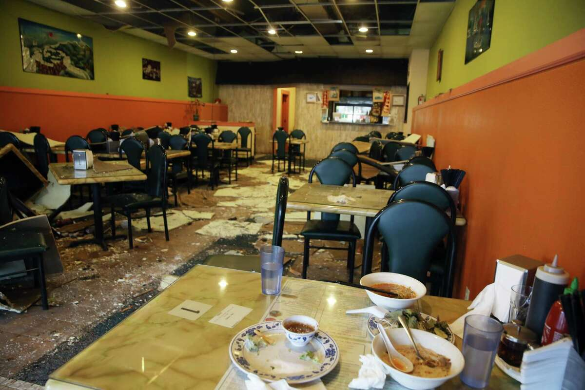 Bowls of pho are left unfinished on a table a day after diners were forced to evacuate Pho Big Bowl due to a three-alarm fire that ripped through businesses on the 2300 block of NW Market Street in Ballard, Tuesday, Oct. 8, 2019. Big Bowl was the least affected of the five damaged businesses on the block.