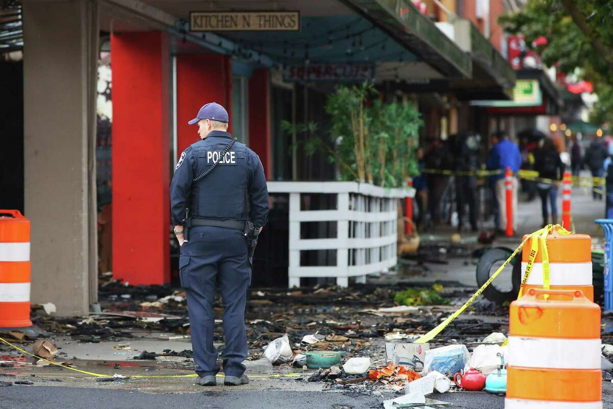 The sidewalk outside of Kitchen N Things is covered in debris a day after a three-alarm fire ripped through five businesses on the 2300 block of NW Market Street, including La Isla, Supercuts, Octo Designs Jewelers and Pho Big Bowl, in Ballard, Tuesday, Oct. 8, 2019. Investigators believe the fire started in the attic space.
