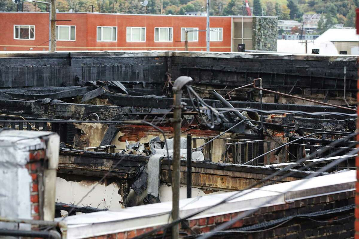 The roof of the business complex on the 2300 block of NW Market Street was burnt and completely collapsed after the three-alarm fire that destroyed five businesses Monday afternoon, Tuesday, Oct. 8, 2019.