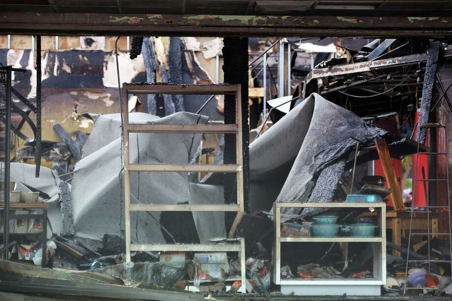 The destroyed interior of Kitchen N Things is visible a day after a three-alarm fire ripped through five businesses on the 2300 block of NW Market Street in Ballard, Tuesday, Oct. 8, 2019. Investigators believe the fire started in the attic space. Photo: GENNA MARTIN, SEATTLEPI.COM / SEATTLEPI.COM