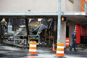 The destroyed interior of Kitchen N Things is visible a day after a three-alarm fire ripped through five businesses on the 2300 block of NW Market Street in Ballard, Tuesday, Oct. 8, 2019. Investigators believe the fire started in the attic space.