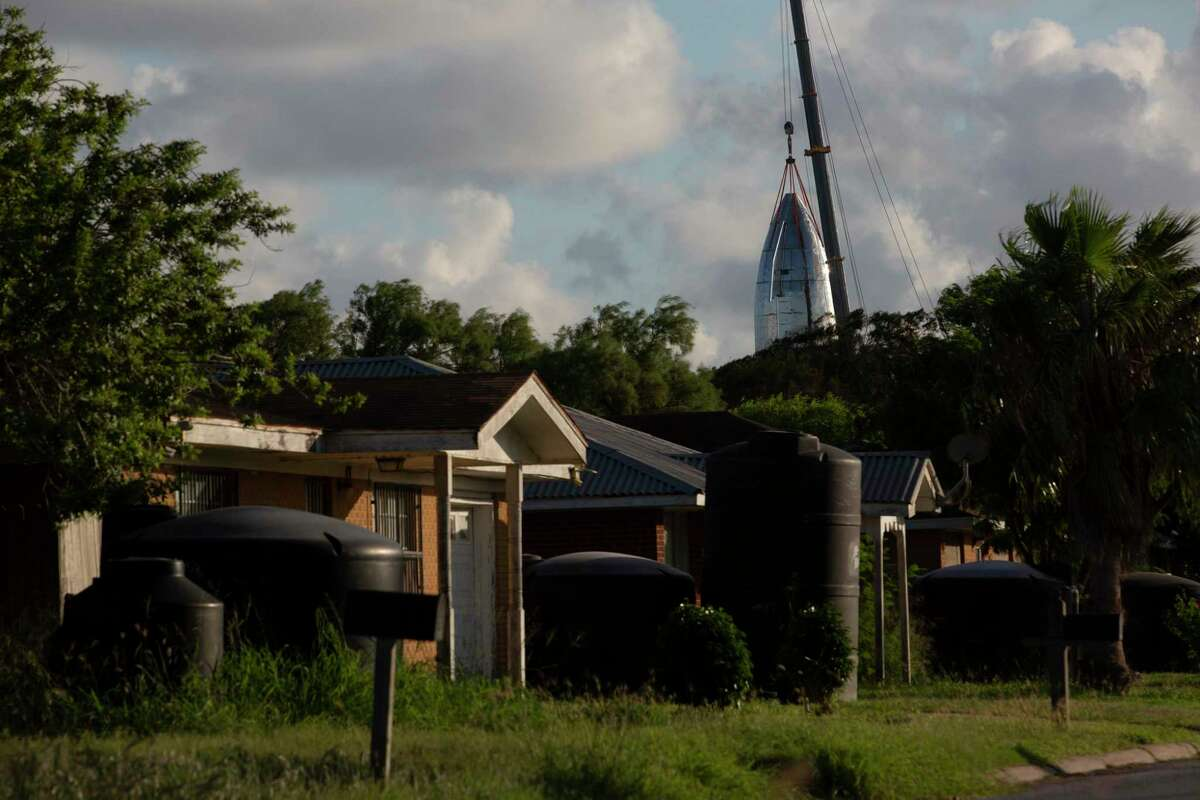 View of SpaceX's Starship vehicle behind a Boca Chica Village home on Friday, Sept. 27, 2019, in Boca Chica. The SpaceX's prototype resembling an old sci-fi movie rocket of the 50s, will be fully reusable transportation system designed to service all Earth orbit needs as well as the Moon and Mars.