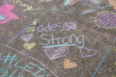 ODESSA, TX - SEPTEMBER 2: A chalk message at a memorial for victims of a mass shooting, at the University of Texas of the Permian Basin (UTPB) on September 2, 2019 in Odessa, Texas. Officials say the suspect Seth Ator, 36, is dead after he killed 7 people and injured 22 in the mass shooting.