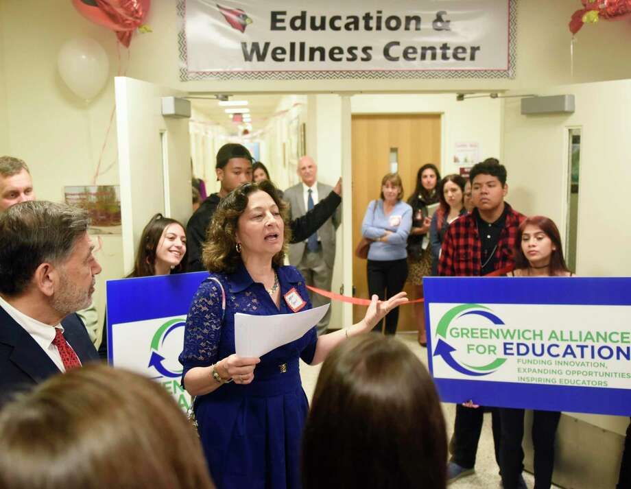 GHS Dean of Student Life Lorraine Termini speaks at the ribbon-cutting of the new Education & Wellness Center wing at Greenwich High School in Greenwich, Conn. Tuesday, Oct. 8, 2019. The Center addresses the complex emotional, academic and behavioral issues of students in a therapeutic and structured setting to support positive mental health and academics. Photo: Tyler Sizemore / Hearst Connecticut Media / Greenwich Time