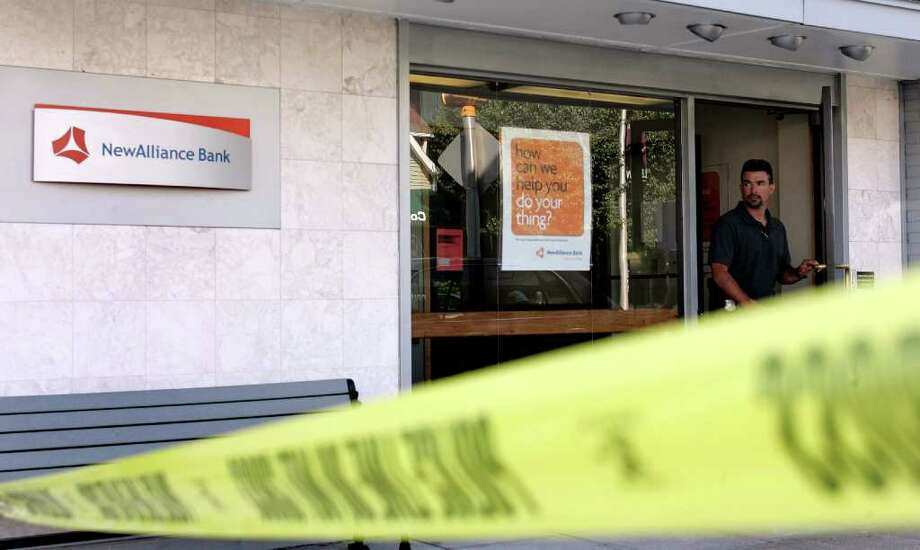 A unidentified member of the Stamford Law Enforcement Community exits the New Alliance Bank on Summer Street, Stamford following a reported bank robbery on Friday afternoon. Photo: J. Gregory Raymond / Stamford Advocate Freelance; © J. Gregory Raymond/for The Advocate
