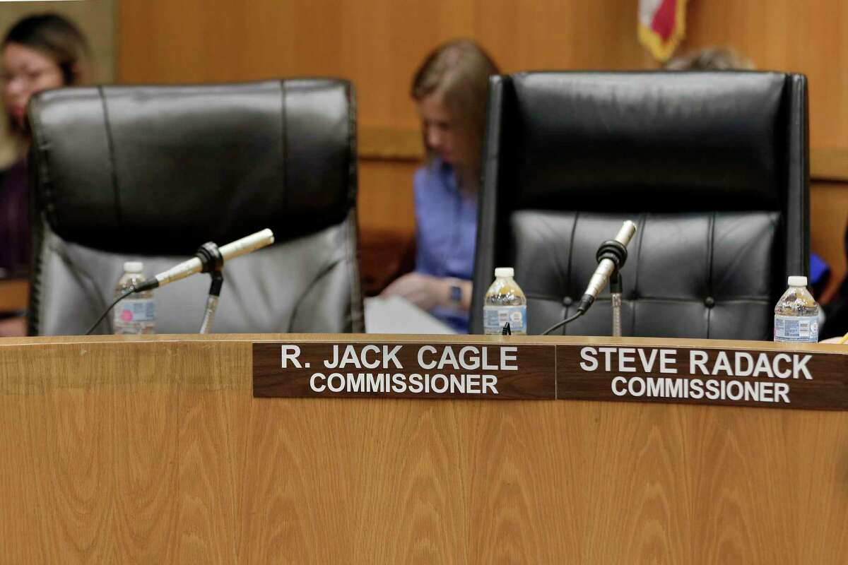 The chairs for county commissioners R. Jack Cagle and Steve Radack are empty on the dais after they did not appear for the Harris Co. commissioners court on Oct. 8, 2019 in Houston.