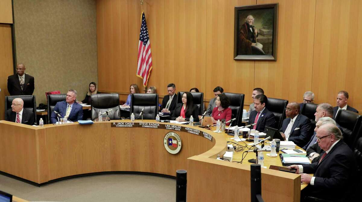 The chairs for county commissioners R. Jack Cagle and Steve Radack are empty on the dais after they did not appear for the Harris Co. commissioners court Tuesday, Oct. 8, 2019 in Houston, TX.