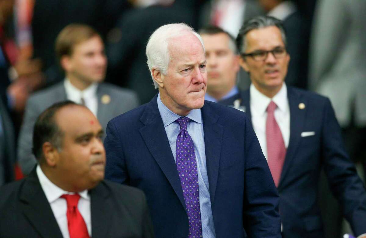 Texas Senator John Cornyn enters the stadium before India Prime Minister Narendra Modi speaks at the Community Summit on September 22, 2019 at NRG Stadium in Houston, Texas. - Tens of thousands of Indian-Americans converged on Houston on Sunday for an unusual joint rally by Donald Trump and Narendra Modi, a visible symbol of the bond between the nationalist-minded leaders. With many in the crowd decked out in formal Indian attire or the signature saffron of Modi's Bharatiya Janata Party, the event kicked off in a football stadium with a Sikh blessing, boisterous bhangra dancing and, in a nod to local customs, cheerleaders in cowboy hats. (Photo by Thomas B. Shea / AFP)THOMAS B. SHEA/AFP/Getty Images