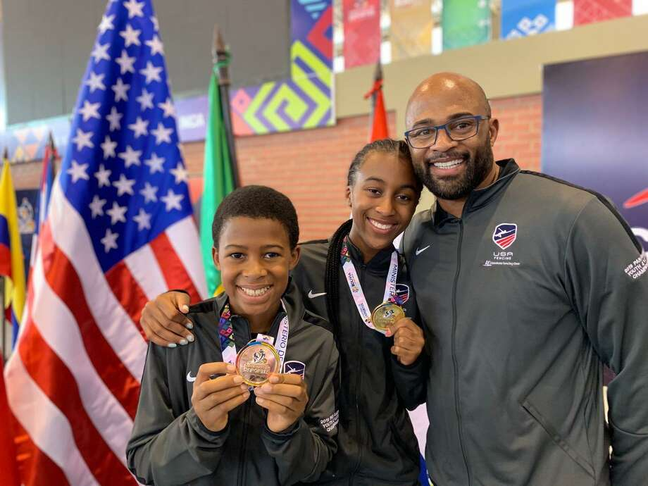 From left to right, Myles Duckett, earned a bronze medal in fencing at the Pan American Youth Championships in Bolivia. His sister Madison Duckett won a gold medal in her division. Joining them is their father, Richard Duckett. Photo: Contributed Photo /Contributed Photo