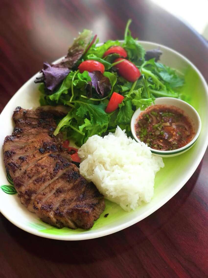 Tiger Tear - grilled marinated strip steak served with sticky rice - is plated at Lime Leaf Thai Bistro, which opened in Troy, N.Y., on Oct. 2, 2019.