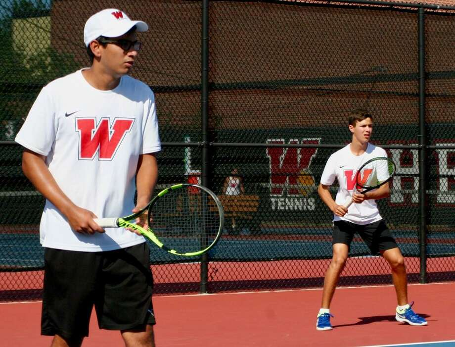 Rock Kanzarkar, left, and Emilio Lopez, right, compete in a boys doubles match for The Woodlands in the fall 2019 season. Photo: Submitted