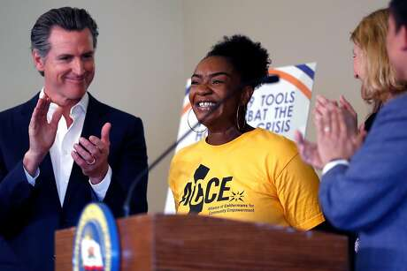 ACCE Action member Sasha Graham is applauded after speaking before California Governor Gavin Newsom signs AB1482, a statewide rent cap bill, at West Oakland Senior Center in Oakland, Calif., on Tuesday, October 8, 2019.