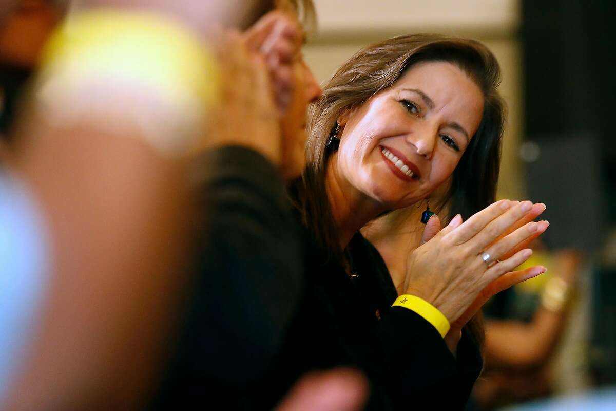Oakland Mayor Libby Schaaf smiles before California Governor Gavin Newsom signs AB1482, a statewide rent cap bill, at West Oakland Senior Center in Oakland, Calif., on Tuesday, October 8, 2019.