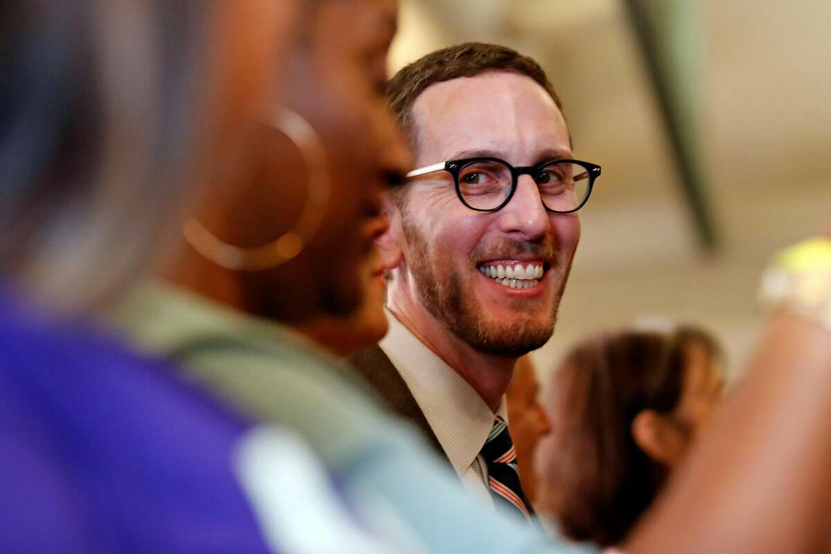 California State Senator Scott Wiener smiles moments before California Governor Gavin Newsom signs AB1482, a statewide rent cap bill, at West Oakland Senior Center in Oakland, Calif., on Tuesday, October 8, 2019.