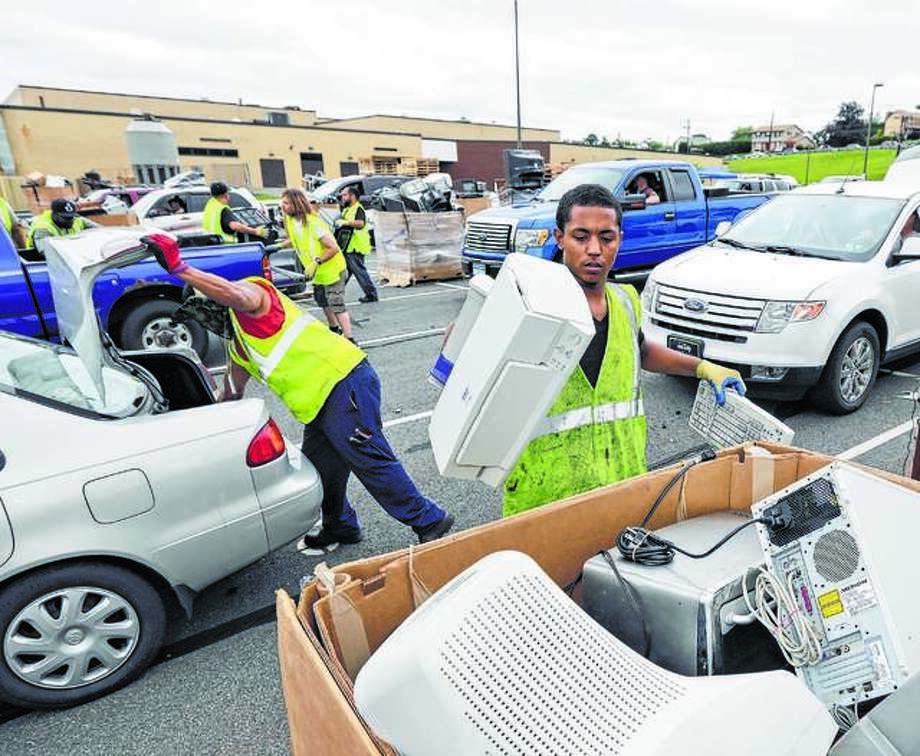 Scenes like this one from 2016 may occur in Glen Carbon Saturday when the village hosts an electronic waste collection and document shredding event at the village hall complex.