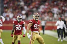San Francisco 49ers defensive end Nick Bosa (97) celebrates in front of middle linebacker Kwon Alexander (56) during the first half of an NFL football game against the Cleveland Browns in Santa Clara, Calif., Monday, Oct. 7, 2019. (AP Photo/Tony Avelar)
