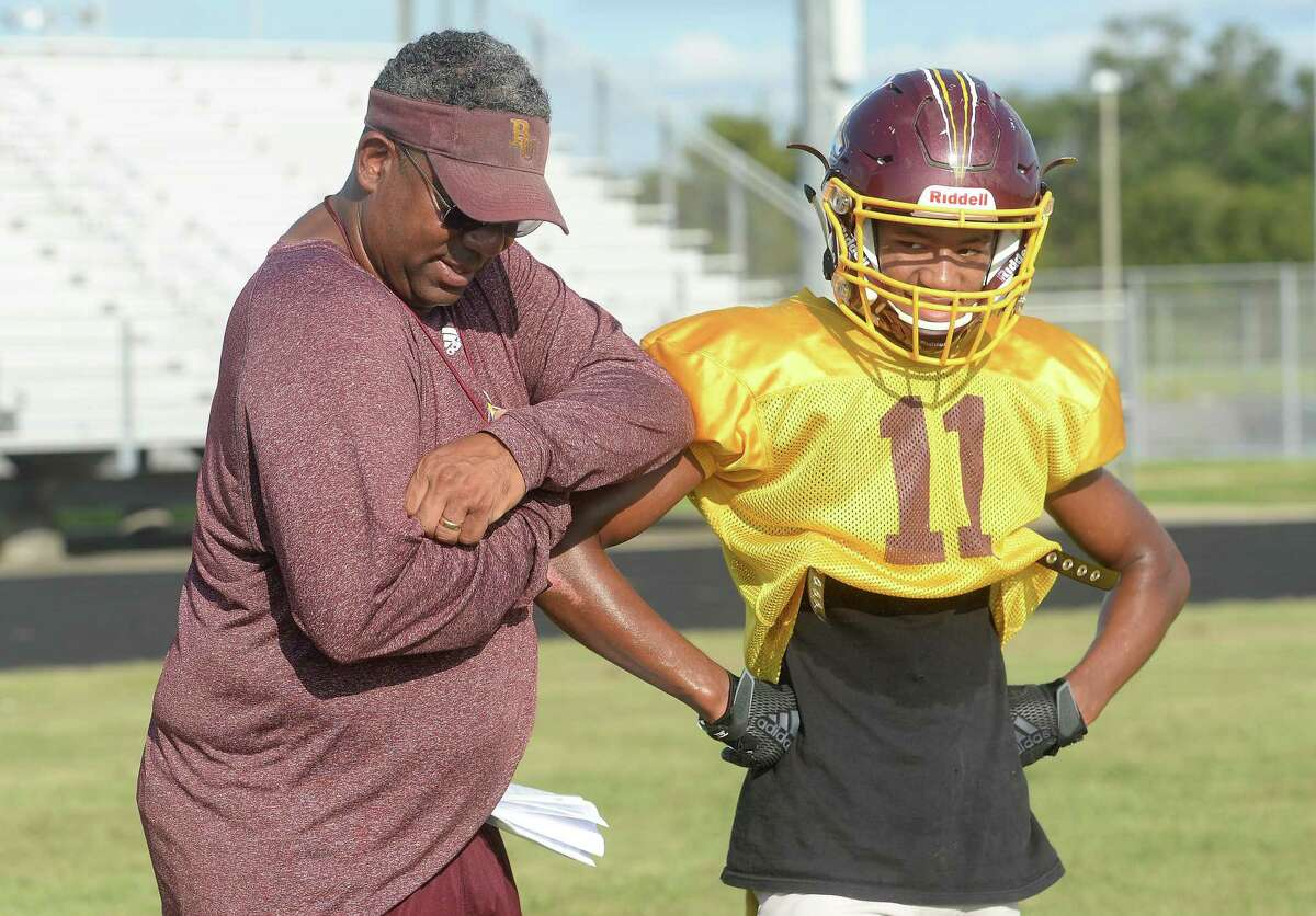Beaumont United head coach Arthur Louis instructs Qaiyyim Abdel as the team practices to prepare for their upcoming game against C. E. King, looking to move beyond their first loss of the season to West Brook in last weekend's Alumni Bowl. Photo taken Tuesday, October 08, 2019 Kim Brent/The Enterprise