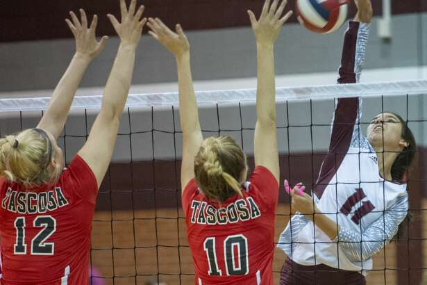 Lee High's Yali Flores goes up for a spike as Tascosa's Taryn Galt and BB Irwin try to block 10/08/19 at Lee High gym. Tim Fischer/Reporter-Telegram