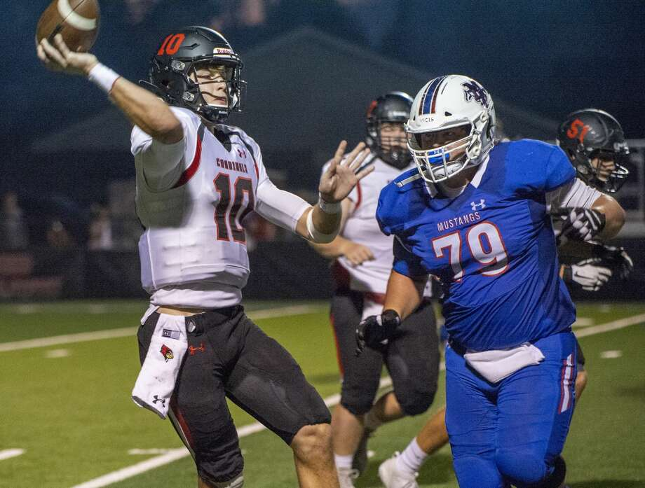 Midland Christian's Michael Madrid chases FW Christian's quarterback 09/27/19 . Tim Fischer/Reporter-Telegram Photo: Tim Fischer/Midland Reporter-Telegram