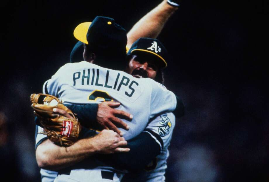 Dennis Eckersley embraces Tony Phillips after the A's completed their sweep of the Giants by winning Game 4 of the 1989 World Series. Photo: Focus On Sport/Getty Images 1989