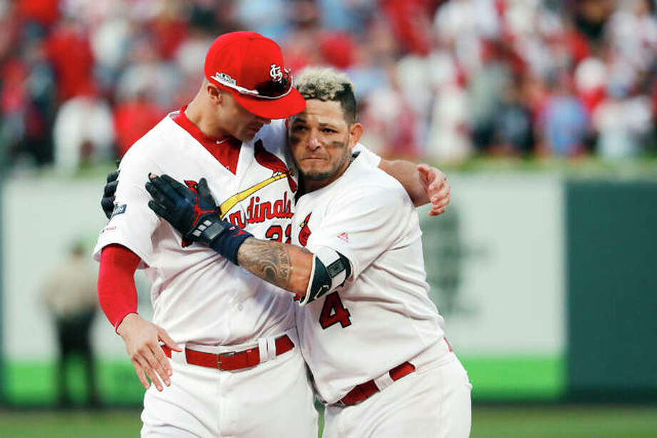 The Cardinals' Yadier Molina, right, celebrates with Jack Flaherty after hitting a sacrifice fly to score Kolten Wong and defeat the Atlanta Braves Monday in Game 4 of a baseball National League Division Series. The best-of-five series is tied 2-2 heading to Wednesday's deciding game in Atlanta Photo: AP Photo