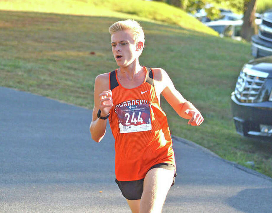Edwardsville's Jack Pifer is on his way to a first-place finish in the large-school boys race at Tuesday's Madison County Meet at Belk Park in Wood River. Photo: Scott Marion/The Intelligencer