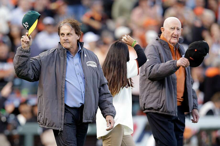 Former A's manager Tony La Russa and former Giants manager Roger Craig are seen on the field before Game 3 of the 2014 World Series at AT&T Park on Oct. 24, 2014. Photo: Ezra Shaw/Getty Images