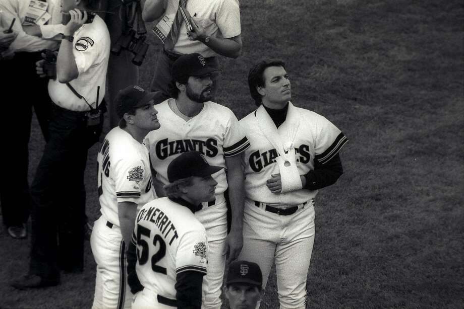 The Giants' Marty DeMerritt, Kirt Manwaring (left), Steve Bedrosian (beard) and Dave Dravecky gathered on the field before the full extent of the Loma Prieta earthquake was known. Photo: John O'Hara/The Chronicle 1989
