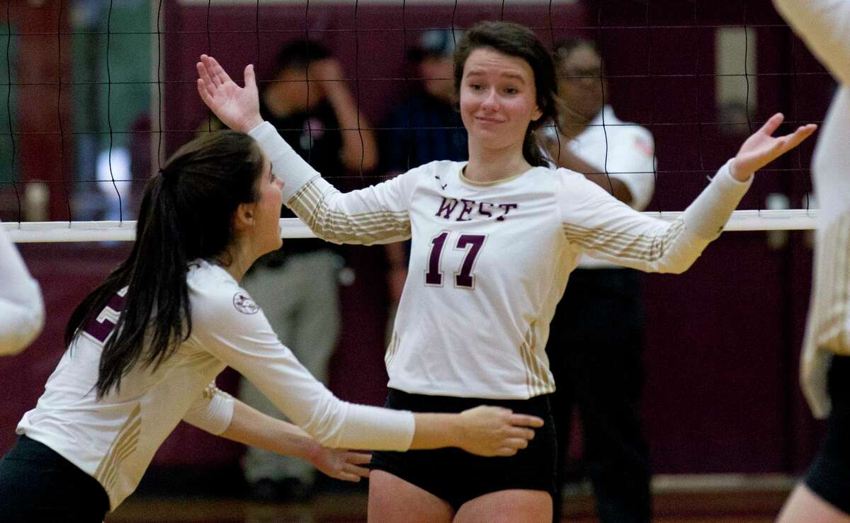 Daylan Meyers #17 of Magnolia West reacts after scoring a point during the first set of a District 19-5A high school volleyball match at Magnolia West High School, Tuesday, Oct. 8, 2019, in Magnolia