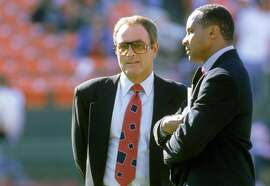 SAN FRANCISCO - SEPTEMBER 5: ABC anchormen (R-L) Al Michaels and Lynn Swann looks on during a game with the Los Angeles Raiders against the San Francisco 49ers at Candlestick Park on September 5, 1994 in San Francisco, California. The 49ers won 44-14. ~~
