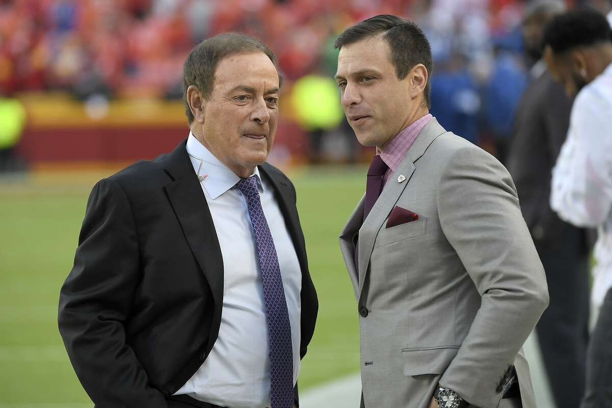 Broadcaster Al Michaels with NBC Sports, left, talks to Brett Veach, general manager of the Kansas City Chiefs, before an NFL football game against the Indianapolis Colts in Kansas City, Mo., Sunday, Oct. 6, 2019. (AP Photo/Reed Hoffmann)al michaels