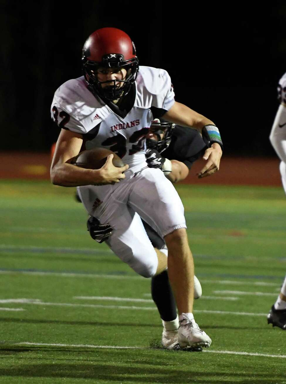 Glens Falls running back Griffin Woodell runs through a tackle by Schuylerville defensive lineman Tyler Bowen during a game Friday, Sept. 13, 2019, in Schuylerville, N.Y. (Jenn March, Special to the Times Union)
