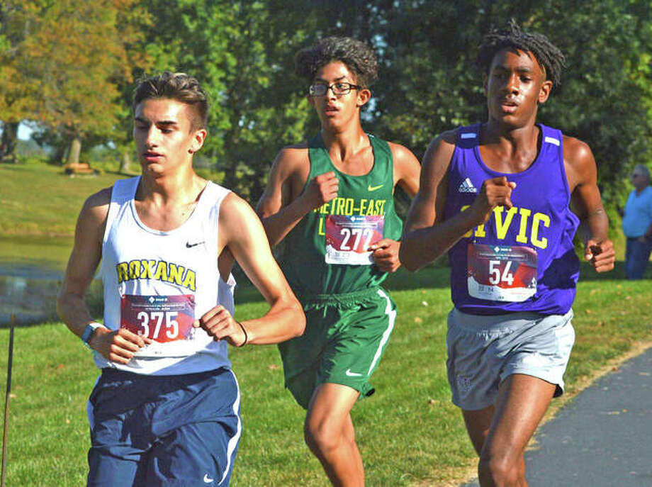 Metro-East Lutheran freshman Elijah Schlessinger, middle, runs on Tuesday in the small-school boys race in the Madison County Meet at Belk Park in Wood River. Schlessinger was declared the winner when the top five runnrs were disqualified for taking a wrong turn.