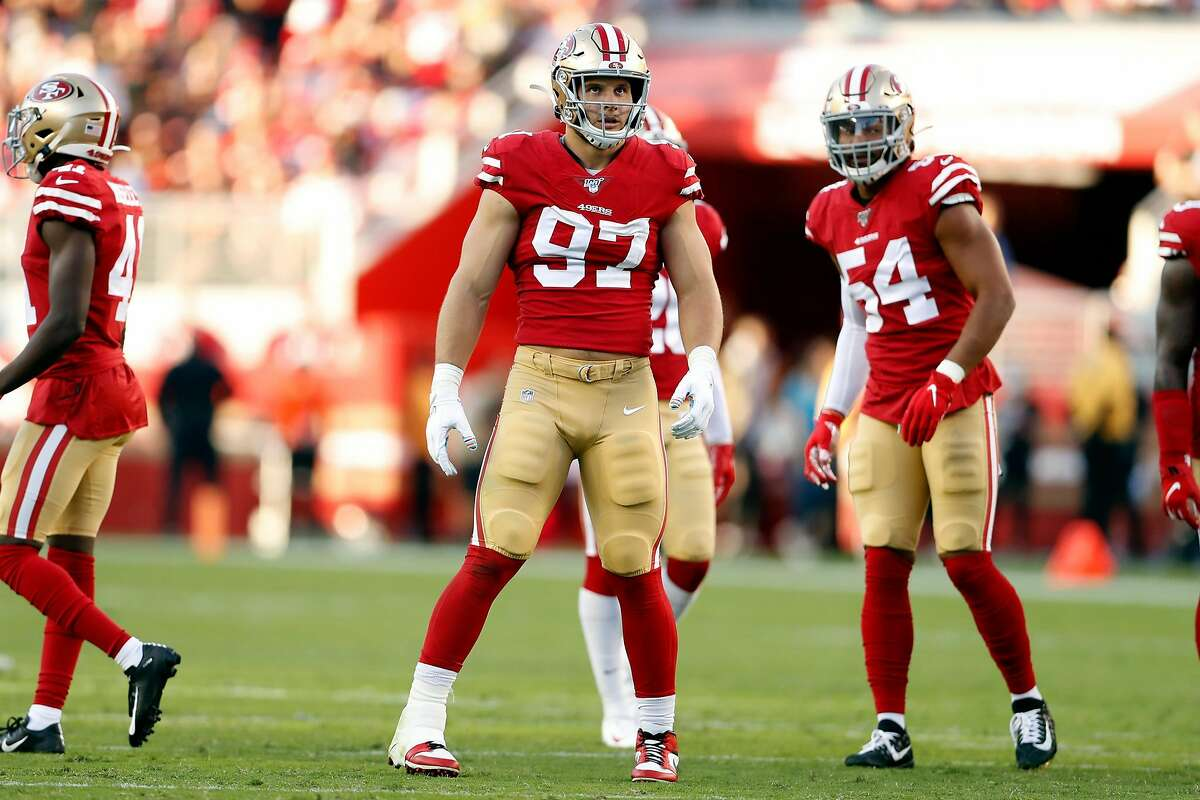 San Francisco 49ers' Nick Bosa and Fred Warner during 31-3 win over Cleveland Browns during NFL game at Levi's Stadium in Santa Clara, Calif., on Monday, October 7, 2019.