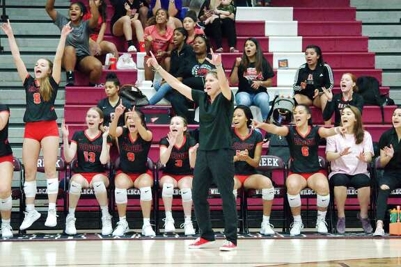 Clear Brook head coach Meredith Thompson and the Lady Wolverines celebrate a point against Clear Creek Tuesday at Clear Creek High School.