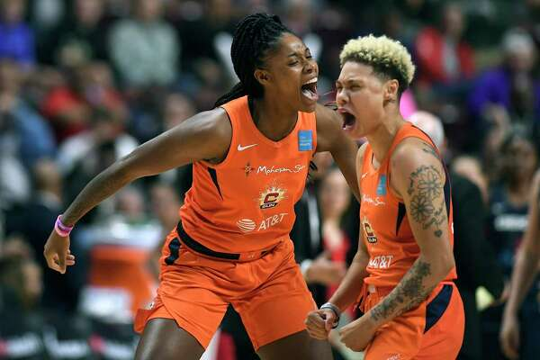 Connecticut Sun's Bria Holmes, left, and Natisha Hiedeman celebrate a basket against the Washington Mystics during the first half in Game 4 of the WNBA Finals on Tuesday, Oct. 8, 2019, in Uncasville.