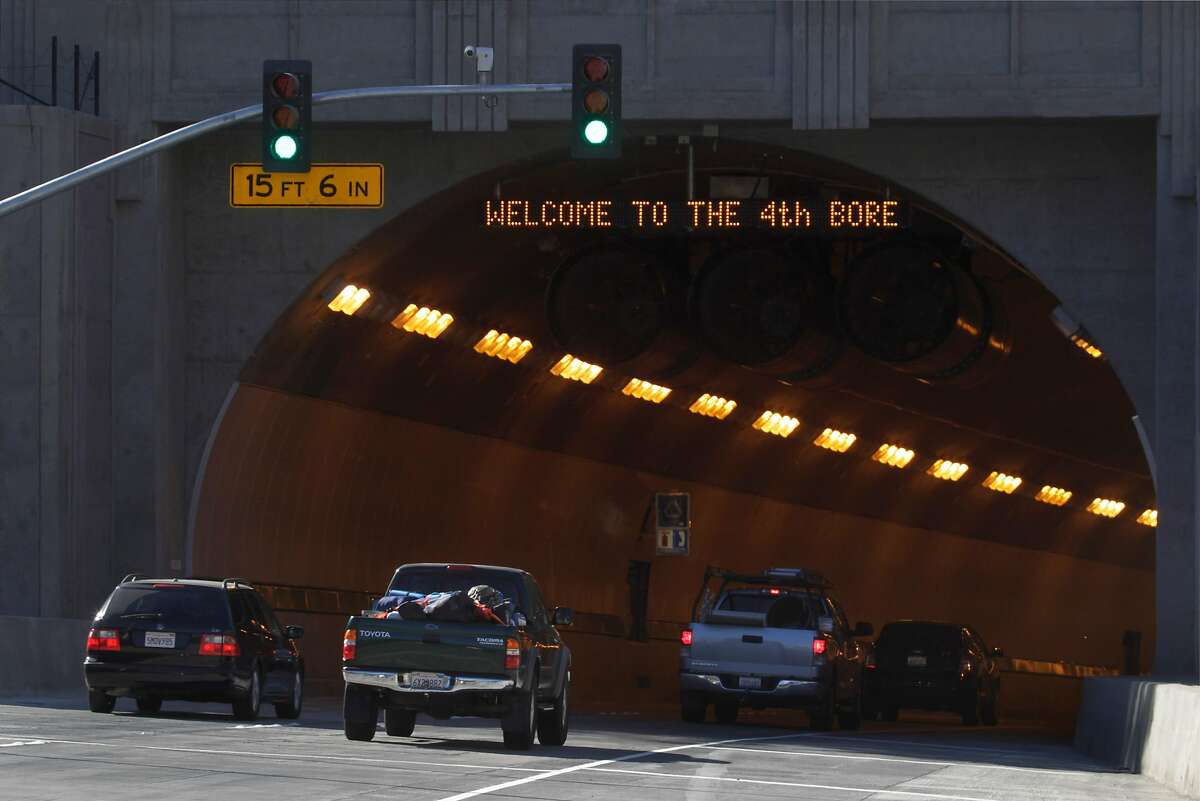 An electronic message sign greets commuters traveling westbound into the new fourth bore of the Caldecott Tunnel in Orinda, Calif., which opened for business on Saturday, Nov. 16, 2013. Adding a fourth tunnel is expected to alleviate choke points that are common in the non-commute direction on Highway 24.