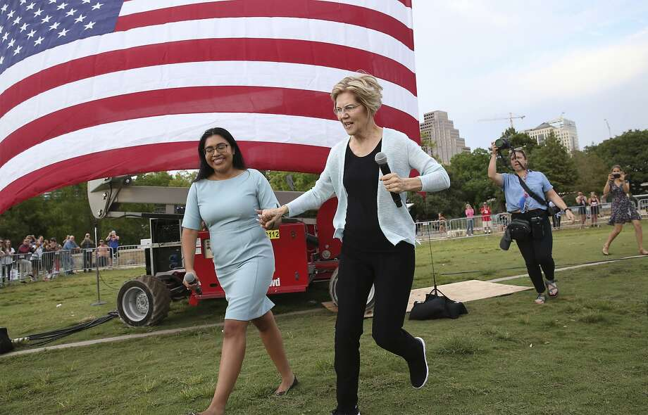 Presidential candidate Elizabeth Warren runs onto the stage with Jessica Cisneros as she holds a town hall meeting at Vic Mathias Shores at Lady Bird Lake Metro Park on September 10, 2019. Photo: Tom Reel, Staff Photographer