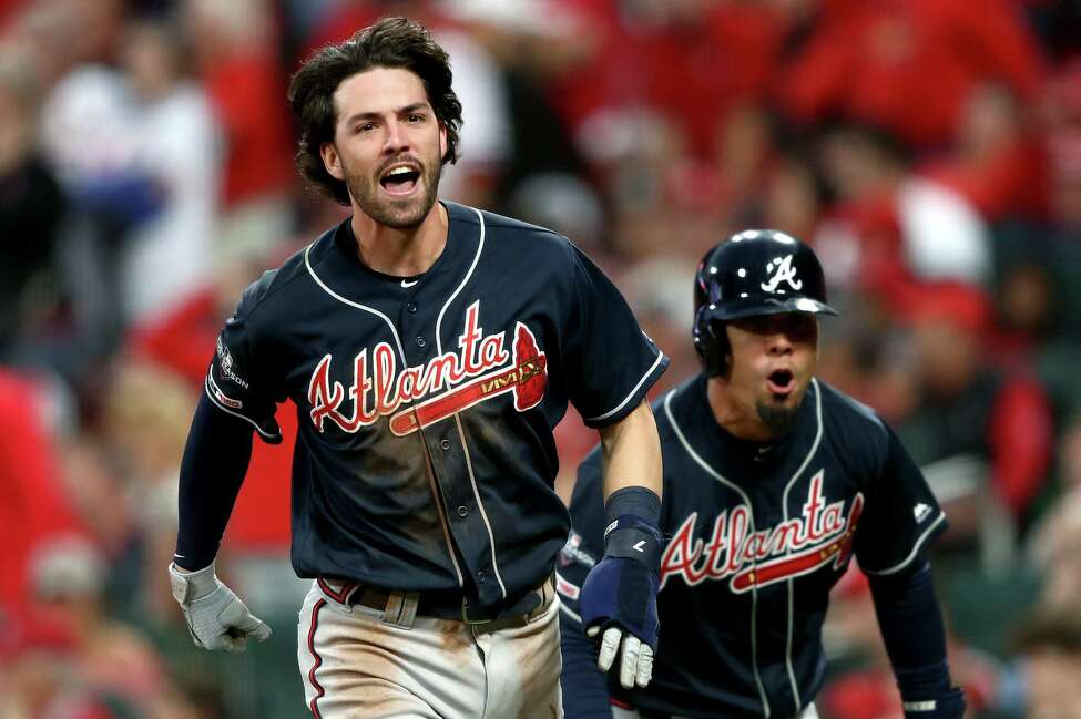 ST LOUIS, MISSOURI - OCTOBER 06: Dansby Swanson #7 and Rafael Ortega #18 of the Atlanta Braves celebrate after scoring the go-ahead runs against the St. Louis Cardinals during the ninth inning in game three of the National League Division Series at Busch Stadium on October 06, 2019 in St Louis, Missouri. (Photo by Jamie Squire/Getty Images)