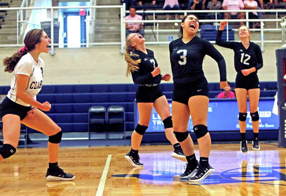 Clark Madison Cuellar,Shadee Briggs,C, Sara Martinez,3, and Taylor McDonough celebrate a point from the District 28-6A high school volleyball showdown between No. 2 Clark and No. 5 Brandeis on Tuesday, October 9, 2019. Clark defeated Brandeis 3-1. Photo: Ronald Cortes/Contributor / 2019 Ronald Cortes